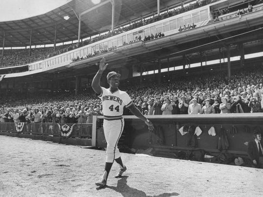 Hank Aaron of the Milwaukee Brewers acknowledges the fans during a game at Milwaukee County Stadium.