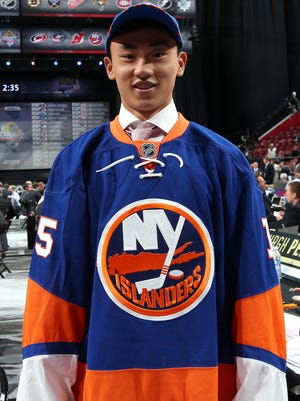 Andong Song reacts after being selected 172nd overall by the New York Islanders during the 2015 NHL draft.