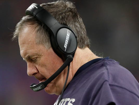 New England Patriots head coach Bill Belichick looks at his plays during the second half of the NFL Super Bowl 52 football game against the Philadelphia Eagles Sunday, Feb. 4, 2018, in Minneapolis. (AP Photo/Jeff Roberson)