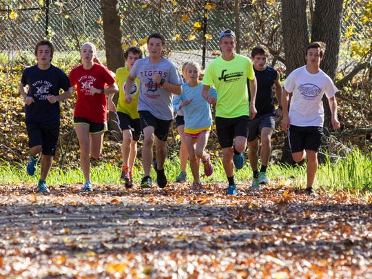 Harper Creek and St. Philip cross country runners warming up at the Ott Biological Preserve.