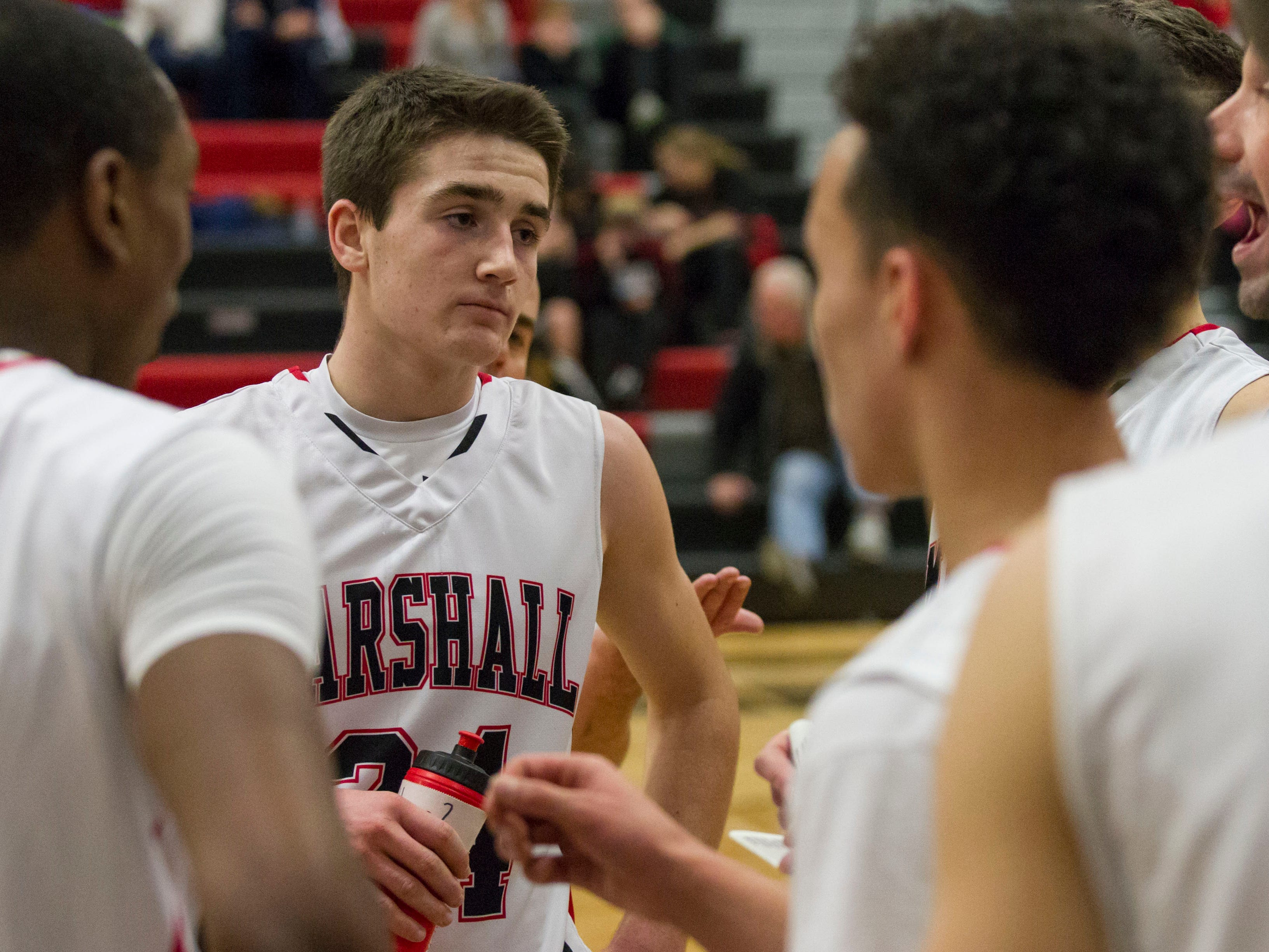 Drew DeVine of Marshall listens to Coach Nicholas Dent during a time out.
