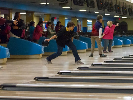Bowlers warm up at M-66 bowl before competing in the Michigan State USBC WBA 88th Annual Tournament.