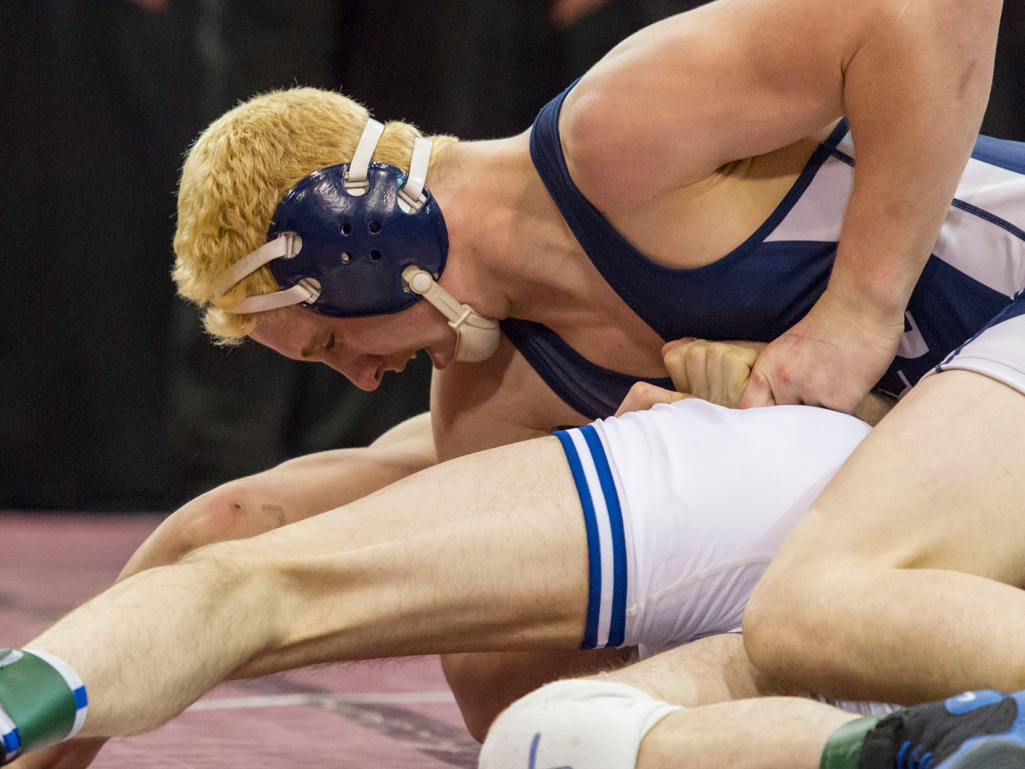 Austin Pawlak of Richmond wrestles with Kyle Motylinski of Dundee in the Division 3 State Championship Final.