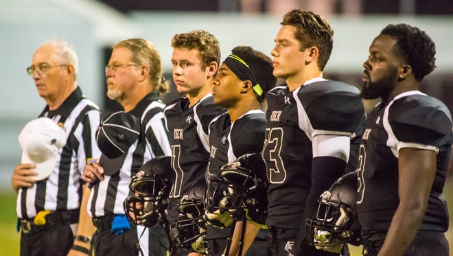 The Sussex Tech captains await kickoff against Salesianum on Friday night at Sussex Tech in Georgetown.