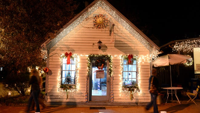 Holiday shoppers walks along Front Street in Dillsboro during a past Lights and Luminaries Festival. The annual event continues Dec. 9-10.