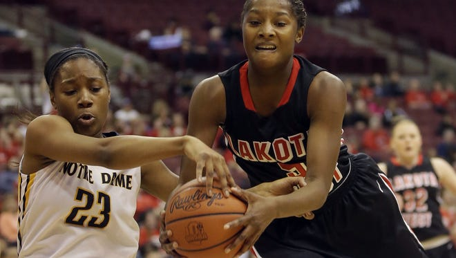 Lakota West's  Nia Staples(5) battles Notre Dame Academy's  Christiana Jefferson for a rebound  during their  State Championship game  Saturday.
