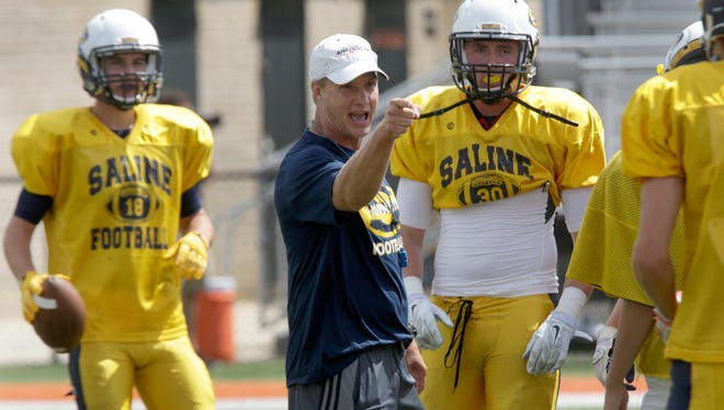 Saline coach Joe Palka directs his team before a scrimmage against Dearborn on Aug. 20.