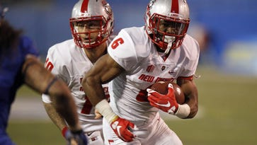 New Mexico Lobos running back Jhurell Pressley (6) runs the ball against the San Jose State Spartans in a game earlier this season.