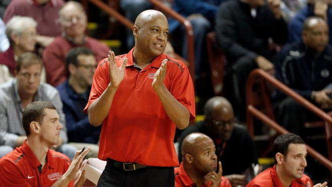 Cornell's head coach Bill Courtney claps for his team during their game against South Carolina during the first half at the Charleston Classic NCAA college basketball tournament in Charleston, S.C.