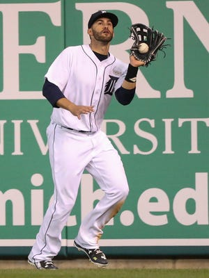 Tigers rightfielder J.D. Martinez drops a fly ball during the seventh inning Monday in Comerica Park.