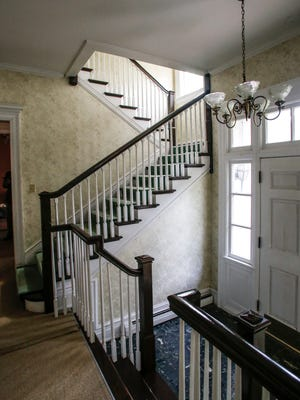 The main entryway and staircase in the historic Cooley-Haze house, a 1903 Colonial Revival house at 213 W. Malcolm X in Lansing, on July 27, 2017. [MATTHEW DAE SMITH/Lansing State Journal]