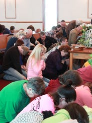 Volunteers and church members pray for Noah Chamberlin