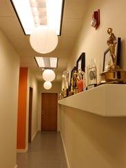 Awards-lined shelf at Dan Yessian Music's Farmington