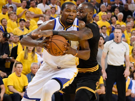 Jun 12, 2017; Oakland, CA, USA; Golden State Warriors forward Kevin Durant (35) is defended by Cleveland Cavaliers forward LeBron James (23) during the first half in game five of the 2017 NBA Finals at Oracle Arena.