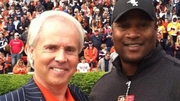 Avid Auburn fan Perry Hooper, Jr., here pictured with 1985 Heisman Trophy winner Bo Jackson, is excited about participating in Auburn Football Fantasy Camp.