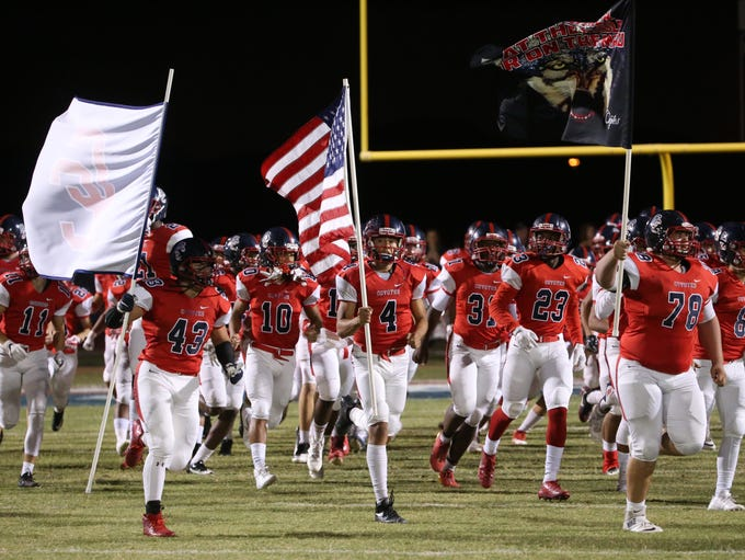 Centennial players take the field to play St. Thomas