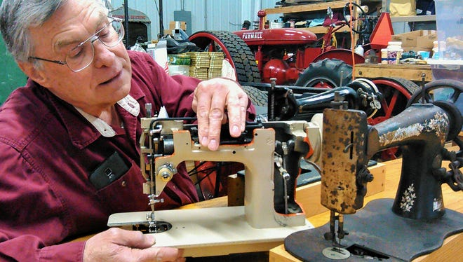Tom Schulein, who could be a poster boy for how to stay busy in retirement, is fascinated with old sewing machines like the antique Singer shown here with its more modern cousin in cutaway form. His workshop also includes farm tractor restoration projects.