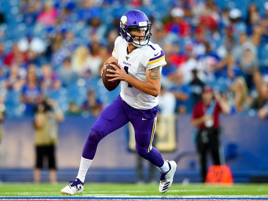 Aug 29, 2019; Orchard Park, NY, USA; Minnesota Vikings quarterback Kyle Sloter (1) rolls out of the pocket against the Buffalo Bills during the first quarter at New Era Field. Mandatory Credit: Rich Barnes-USA TODAY Sports