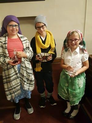 From left,  Hannah Hartigan portrays Lucia dos Santos, Caleb Grant is Francisco Marto and Breanna Meyer is Jacinta Marto for the 100th Anniversary celebration Mass.