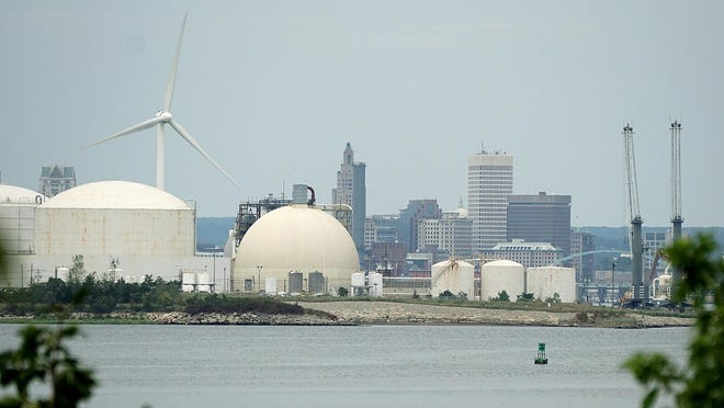 Fields Point's oil and liquefied natural gas storage tanks with the Providence skyline beyond as seen from East Providence on Friday.