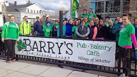 Jessica Barry (left) and Alana Russell (far right) with the Barry's Runners outside Barry's Old School Irish before the second run/walk (Provided photo)