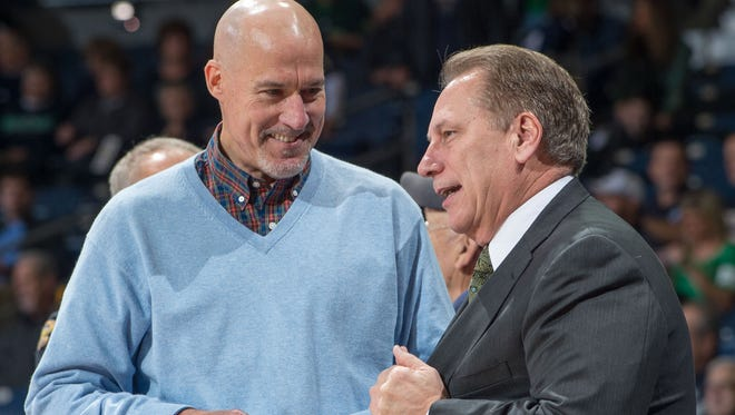 Former Notre Dame star John Paxson chats with Michigan State coach Tom Izzo before the Spartans faced the Irish on Dec 3, 2014 in South Bend, Indiana.