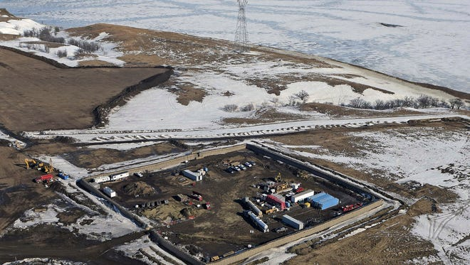 """In this Feb. 13, 2017, aerial file photo shows the site where the final phase of the Dakota Access pipeline will take place with boring equipment routing the pipeline underground and across Lake Oahe to connect with the existing pipeline in Emmons County near Cannon Ball, N.D. Environmental activists who tried to disrupt some oil pipeline operations in four states to protest the pipeline say they aren't responsible for any recent attacks on that pipeline. Dakota Access developer Energy Transfer Partners said in court documents Monday, March 20, 2017, that there have been """"coordinated physical attacks"""" along the $3.8 billion pipeline that will carry oil from North Dakota to Illinois. (Tom Stromme/The Bismarck Tribune via AP, File)"""