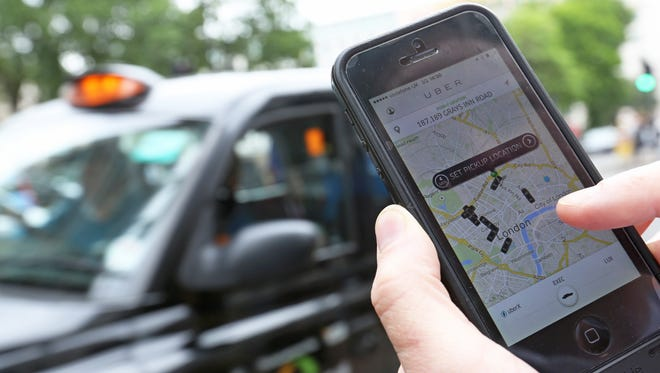 A user scans for an available vehicle using Uber's app.