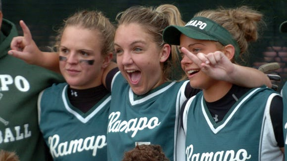 From 2006: Ramapo pitcher Brittany Baiunco (7)(center) celebrating Ramapo's 3 - 0 win over Tenafly Sunday in the Bergen County Girls Softball Tournament Final at Northern Valley Old Tappan High School in Old Tappan.  Sam Depken (4) is left and Amy Piccinich (11) is right.