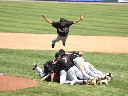 Marlboro's Austin Casey dives into the dogpile after