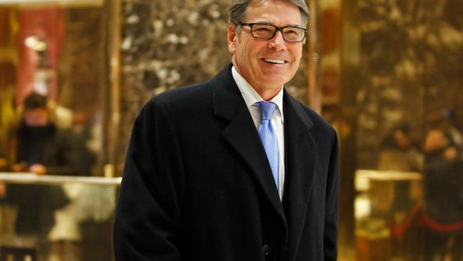 In this Dec. 12, 2016, file photo, former Texas Gov. Rick Perry smiles as he leaves Trump Tower in New York. President-elect Donald Trump selected Perry to be secretary of energy.
