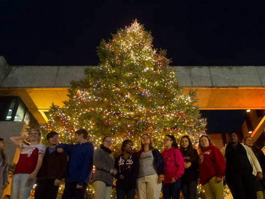 Members of the Harrison High School choir gather in front a 25-foot tall Blue Spruce tree at the Civic Center for the annual Christmas Tree Lighting Ceremony, Friday, Nov. 18, 2016.
