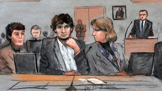 In this March 5 courtroom sketch, Dzhokhar Tsarnaev, center, is depicted between defense attorneys Miriam Conrad, left, and Judy Clarke, during his federal death penalty trial in Boston.