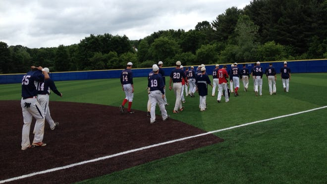 Members of the Roy C. Ketcham High School baseball team walk off the field at Maine-Endwell High School after losing in the Class AA state semifinals to Shenendehowa, 5-0, on Saturday.