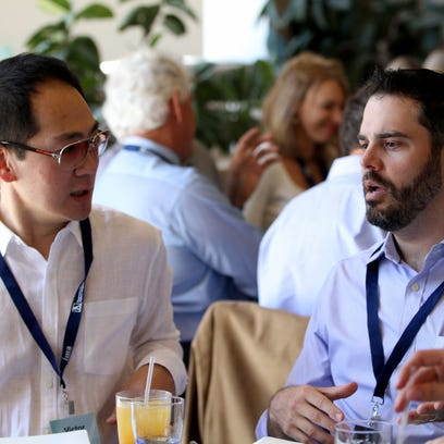 Evite.com CEO Victor Cho, left, and Don Osmond, managing