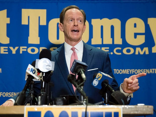 In this Oct. 11, 2016, photo, Sen. Pat Toomey, R-Pa., campaigns in Villanova, Pa. Control of the Senate hung in the balance Nov. 5 as candidates from Nevada to New Hampshire made their closing pitches to voters after a tough and costly campaign.