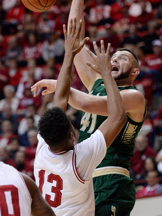 Indiana Hoosiers forward Juwan Morgan (13) defends South Florida Bulls center Nikola Scekic (41) as he loses the ball shooting during the Indiana South Florida NCAA men's college basketball game at Simon Skjodt Assembly Hall in Bloomington, Ind., Sunday, Nov. 19, 2017. (Chris Howell/The Herald-Times via AP)