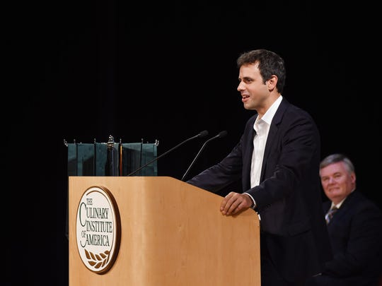 Matthew Wadiak, a Culinary Institute of America alumnus and founder and COO of Blue Apron, gives the keynote address at a Culinary Institute of America graduation at the Marriott Pavilion on campus in Hyde Park.