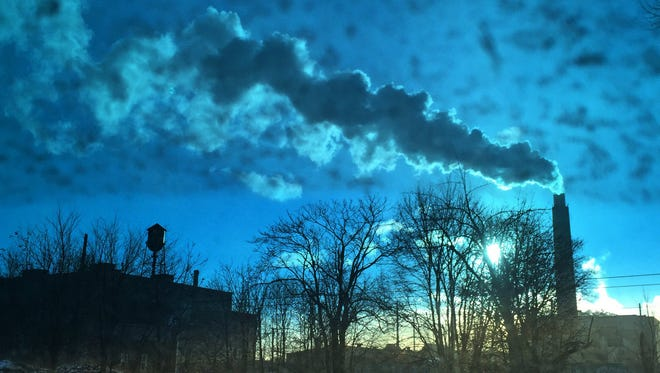 Steam from Detroit's incinerator rises above an empty lot and abandoned warehouse on a bitterly cold Wednesday. More frigid cold is expected today.