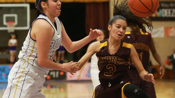 Burges' Denise Ramos, left, and Andress' Jordan Pinson battled for the ball during the first quarter Friday.