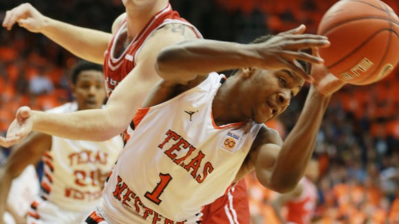 """UTEP's Dominic Artis, right, and Western Kentucky's Justin Johnson battled for a loose ball during the first half  2016 in El Paso, Texas. Both teams are wearing """"throwback"""" 1966 uniforms. (AP Photo/El Paso Times, VIctor Calzada)"""