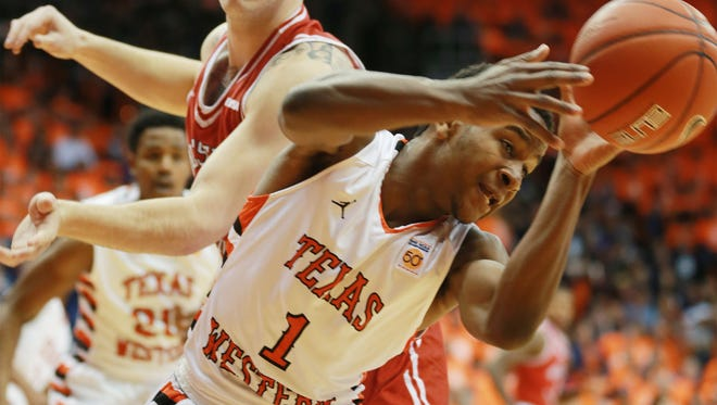"UTEP's Dominic Artis, right, and Western Kentucky's Justin Johnson battled for a loose ball during the first half  2016 in El Paso, Texas. Both teams are wearing ""throwback"" 1966 uniforms. (AP Photo/El Paso Times, VIctor Calzada)"