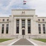 The Marriner S. Eccles Federal Reserve Board Building stands in Washington. The Fed is getting close to raising interest rates for the first time in nearly a decade.