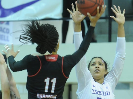 ACU's Makayla Mabry, right, defends as Incarnate Word's Imani Robinson shoots. Robinson made the basket, tying the game at 56 with five seconds left in the game. Sara Williamson scored at the other end, lifting ACU to a 58-56 victory in the Southland Conference game Saturday, Feb. 10, 2018 at Moody Coliseum.