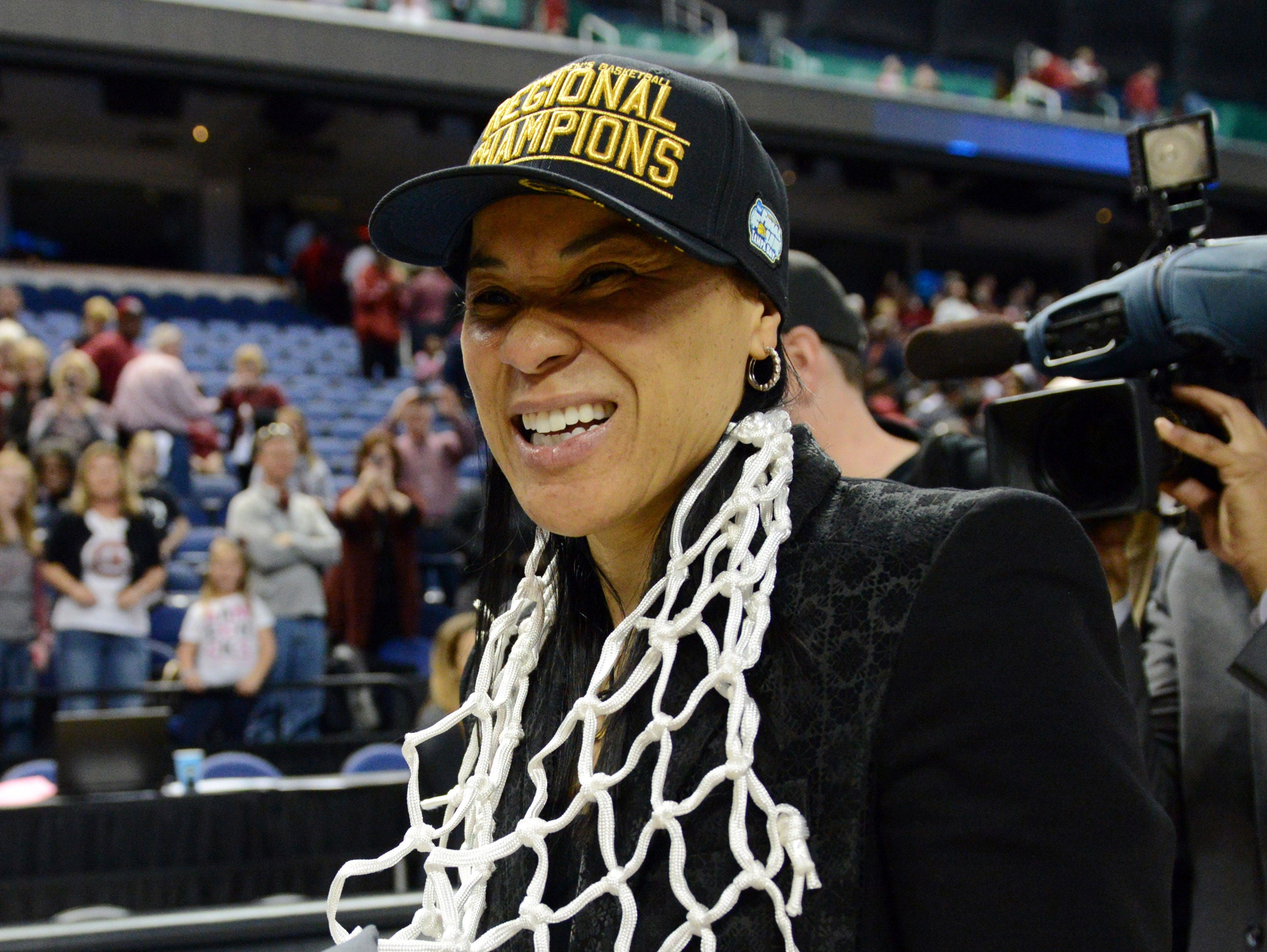 South Carolina Gamecocks head coach Dawn Staley reacts after her team defeated the Florida State Seminoles in the finals of the Greensboro Regional of the 2015 women's NCAA Tournament at Greenboro Coliseum Complex. South Carolina won 80-74.