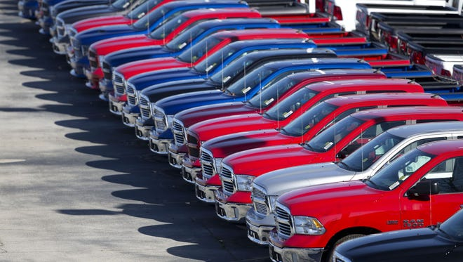 Dodge Ram pickup trucks are on display on the lot at Landmark Dodge Chrysler Jeep Ram in Morrow, Ga.