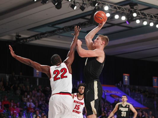 Purdue center Isaac Haas (44) shoots over Western Kentucky forward Dwight Coleby (22) during an NCAA college basketball game Thursday, Nov. 23, 2017, in the Battle 4 Atlantis tournament in Paradise Island, Bahamas. (Tim Aylen/Bahamas Visual Services Photo via AP)