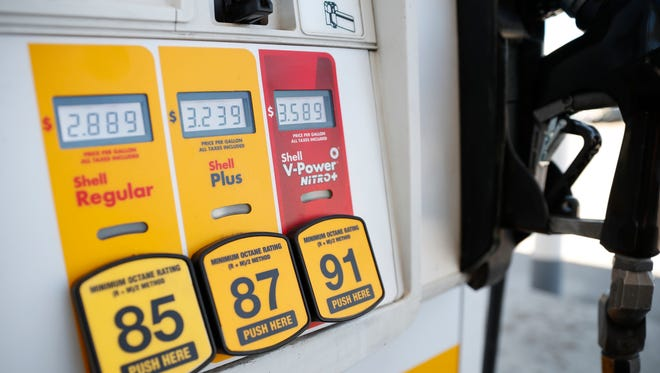 Prices for the three grades of gasoline light up the pump at a Shell station in southeast Denver. On Tuesday, June 12, the Labor Department reports on U.S. consumer prices for April.