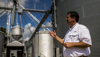 Richard Fontenot explains the systems used to store and distribute grain at his family's rice farm in Ville Platte during a 2015 interview.
