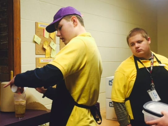 Trevor Teumer, left, shows Z Krause, right, how to